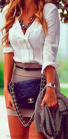 Mini skirt with white shirt and Coco Chanel handbag. Skirt could be longer though.