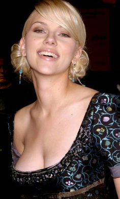 Scarlett Johansson- what a tease!? She's begging someone to give her tit a squeeze!