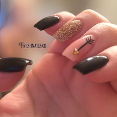 Black nails with gold and nude accent nail. Arrow nail art