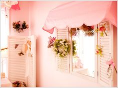 I like the idea of adding shutters and awning to a mirror to make it look like a window. Maybe even a flower box?