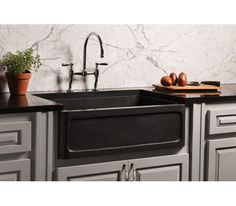 Stone Forest's New Haven Farmhouse Sink carved from honed basalt. https://www.stoneforest.com/ http://productfind.interiordesign.net/products/20741-new-haven-farmhouse-sink-honed-basalt/