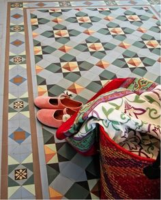 Gorgeous Winckelmans tile floor pattern and border in soft colors-