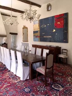 """One of our artists, Kevin Ghiglione, was recently commissioned to create this large encaustic painting for a home in the French countryside. This French Chateau was built in the 14th century and looks out onto a beautiful vineyard! Here is a photograph of the painting hanging insitu. """"Silence Between Kingdoms"""" Kevin Ghiglione Encaustic on triptych birch panel 79"""" x 144"""" To inquire about commissions, please call 416-974-9986."""