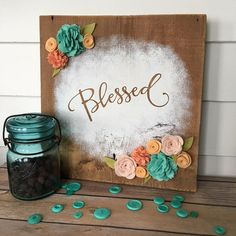 Freshen up your decor with this sweet sign. Painted on reclaimed barn wood and accented with felt flowers, this will look great in any decor.  Sign measures approx. 11-1/2 x 11-1/2 - includes sawtooth hanger  Want flowers in a different color? No problem - just let us know what colors youd prefer and well customize it for you