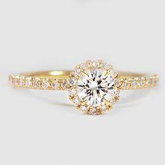 A stunning halo diamond ring.