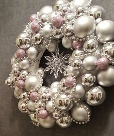 What an elegant, glamorous ornament wreath for elegant Christmas decorating. I can just see this wreath lit by Christmas lights. Im definitely making one of these this Christmas christmas decor diy Modern Christmas Ornaments, Elegant Christmas Decor, Silver Christmas Decorations, Christmas Ornament Wreath, Shabby Chic Christmas, Gold Christmas, Holiday Wreaths, Christmas Crafts, Christmas Lights