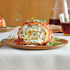 """Tomato-Basil Lasagna Rolls   MyRecipes.com  Delicious!  I substituted spinach for the artichoke hearts and it was a hit~hubby deemed it """"very company-worthy!""""  Hurrah!"""