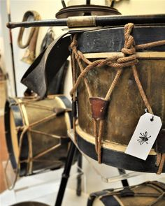 French Napoleonic Era Antique Snare Drums Complete with Sticks in Belts and Antique Brass French Bugle @ Interiors Market ATL: Antique, Vintage, Modern, and Contemporary Furniture, Art, Decor, Lighting and More!