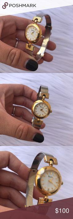 BULOVA WOMENS GOLD SILVER TONE WATCH BANGLE STYLE Beautiful 100% authentic bulova woman's vintage watch ❤ the gold around the face is fading a little and on the claps too but still looks gorgeous on and is in working order with a new battery :) any questions please ask babes:) Bulova Accessories Watches