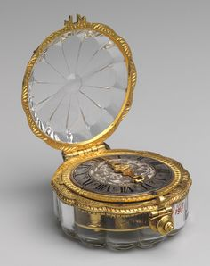 Watch, ca. 1650-60. Movement by Jean Rousseau the Younger (Swiss, 1606-1684)Case: rock crystal mounted in gilded brass; Dial: silver, with single gilded brass hand; Movement: gilded brass and steel, partly blued