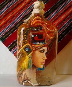 Guatemalan artist Sonia Muralles transforms bottles into beautiful pieces of art.