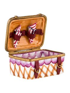 Multicolor hand painted Limoges porcelain Rochard picnic basket-form box with napkin and plate surprises at interior and brand signature at underside.