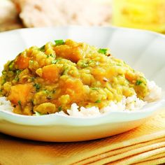 More than 60 different types of dal (or dhal) are made across India. The basic dish contains lentils or other legumes flavored with aromatics and spices. Here, yellow lentils (toor dal) and mango are cooked in a more traditionally Southern India style--more souplike. Both ripe and underripe mango will work: less-ripe mango imparts a tart flavor and holds its shape, while riper mango breaks down more during cooking and gives the dish a sweeter taste. Serve over basmati rice or with roasted…