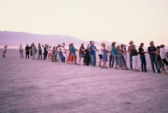 "Burning Man 1990  Photo by Danger Ranger  ""First group lift of the Man at Black Rock, first time the Man was raised at Black Rock. This is most of the people who came up for Zone Trip #4."""