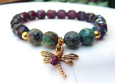 This favorite Dragonfly Bracelet is made with 8mm African Turquoise and accented in deep purple glass beads. it is adorned with a pretty Dragonfly charm and small handmade Amethyst Swarovski Crystal.