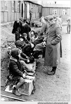 Russian boys give German soldiers a shoe shine, 1942