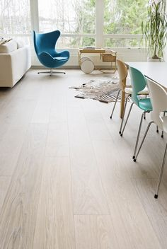 Oak 222 Arctic brushed wax oiled, private house in Espoo, Finland. Arctic is one of the first colors we have, and still going strong, and no wonder! White Wooden Floor, Wooden Flooring, Home Office, Dining Chairs, Living Room, Interior Design, Wax, House, Inspiration