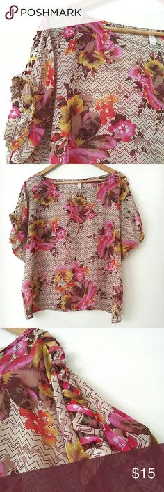 """Xhilaration Floral Dolman Cold Shoulder Top Add a fun layer with this pretty top! Dolman style wide sleeves with shoulder criss cross cutouts & button closure. Boxy loose fit. Front is slightly shorter than back hem. In perfect condition! I just don't like how it fits my hips. (I've got child-bearing hips)  {Measurements} Across Chest: 26"""" Front Length: 22"""" Back Length: 25"""" Across Bottom Hem: 20""""  {Materials} 100% Polyester Xhilaration Tops"""