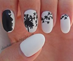 Cover your nails in striking matte white polish as base for your Dandelion nail art. A black silhouette of lady blowing away a Dandelion flower and scattering petals across the rest of the nails.