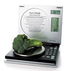 Salter Nutri-Weight Dietary Computer Scale - This brilliant gadget not only weights the food, it analyzes its nutritional content by portion size so you see the calories, protein, carbs, sugar, fat, fiber, sodium, cholesterol and more.  It also stores this info for 100 recipes and lets yo record yor daily food intake.