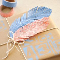 How to make washi tape feathers to add as gift toppers to  your packages!