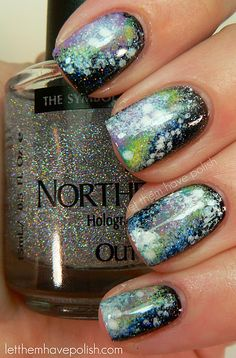 Galaxy nails! talent.  try this...get a bowl of water, pour little bits of all the different shades you want, it should float on the top, swirl with a toothpick or something like it and when it looks like you want on top of the water, then dip your nails through the water...fantastic idea!!