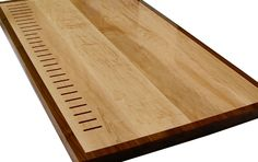 Face Grain Hard Maple Island Countertop with Integrated Knife Slots and Walnut Banding