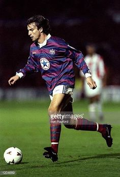 David Ginola of Newcastle United in action during a Coca Cola Cup Third Round match against Stoke City at the Victoria Ground in StokeonTrent England. Newcastle Shirt, David Ginola, Newcastle United Football, St James' Park, Stoke City, Coca Cola, Third, Soccer, Army