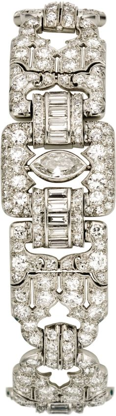 Art Deco Diamond, Platinum Bracelet. The bracelet featuresmarquise-shaped diamonds weighing a total of approximate...