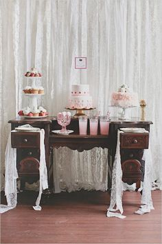 Pink and white colored desserts and drinks on a vintage desk
