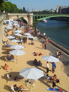 - Paris-plage 2013 >>> I love the way they truck in a beach and turn a Seine quayside into a beach each summer. Just one of the many reasons I adore the place.