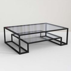 Minimalistic black metal frame and glass coffee table. | www.bocadolobo.com #interiordesign #decor #moderncoffeetables #moderncentertables
