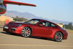This picture of my favourite car called Porche 911. I love car that are slim and small so it is also fast.