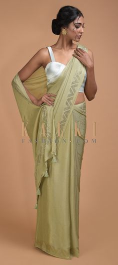 Buy Online from the link below. We ship worldwide (Free Shipping over US$100)  Click Anywhere to Tag Nature Green Saree In Chiffon With Badla Buttis All Over Online - Kalki Fashion Nature green saree in chiffon with badla buttis all over.Border enhanced with badla work in geometric pattern.
