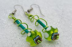 A sweet pair of earrings!  Double Twist Glass Bead and Colored Wire Earrings by Modaluxxe