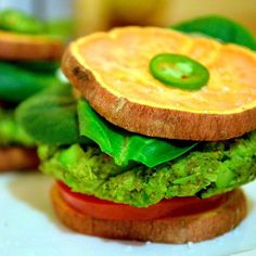 "What do you think about green burgers? This vegetarian recipe is just delicious and packed with healthy plant protein! To make the ""burger buns"" I used sweet potatoes sliced thin and baked. I do this with my sweet potatoes often and use them as ""crackers,"" buns or simply a yummy side. You can stack these burgers up with …"