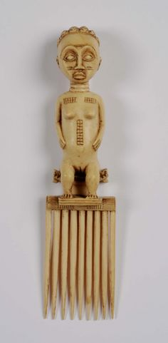 Africa | Comb from the Baule people of the Ivory Coast. Ivory; 20.5 cm