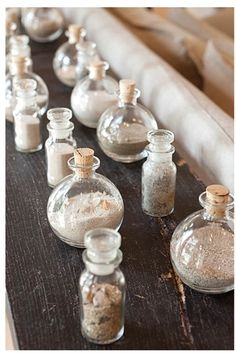 This is a sand collection. Little pretty bottles of sand from vacations at the beach, like a small memory of a happy day!