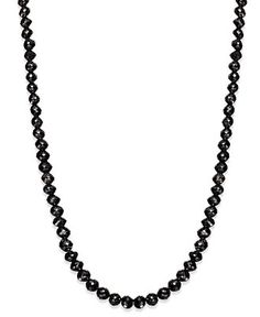 Bold and beautiful, this 14k gold necklace sparkles with bead-cut black diamonds