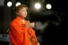 Shinso Ito praying at Ala Moana Floating Lantern Ceremony to light the way for loved ones.