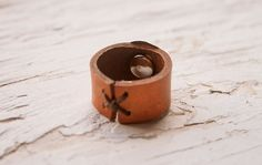 Southwestern Silver Concho Leather ring - Tooled Sunburst Design - Unisex - Hand stamped - Made to Order. $17.00, via Etsy.
