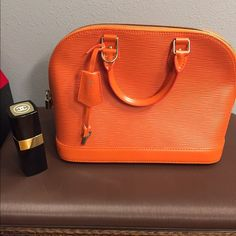 Orange Lv Alma size MM Try to down side my closet. I'm selling all the stuffs I don't use and use money to donate to a charity that I'm currently support. This purchased at a consignment store and I'm not sure if it's A U T H . Haven't use it at all. In excellent condition. Louis Vuitton Bags