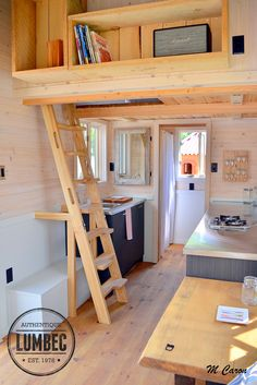 The micro-house from Tiny House Lumbec, a 136 sq ft tiny house on wheels. / hidden loft