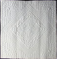 Wholecloth quilting by Margo Cope, designed by Mary Cook. Mannin Quilters http://www.manninquilters.org/Wholecloth.htm