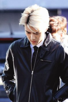sehun,  he look like a mob with that leather jacket and platinum hair but i love it nevertheless  (such a fanfic inspiration)