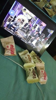 Eating some biscuitwhile wating a program named strong heart