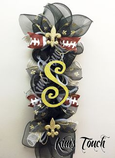 A personal favorite from my Etsy shop https://www.etsy.com/listing/449665570/new-orleans-saints-deco-mesh