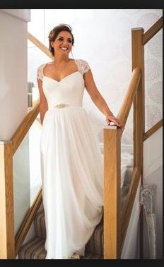 5cec79b6a28 Bride wears stunning  Cherish  wedding dress by Suzanne Neville - Image by  Photography - Cherish by Suzanne Neville and bridesmaid dresses by Maids To  ...