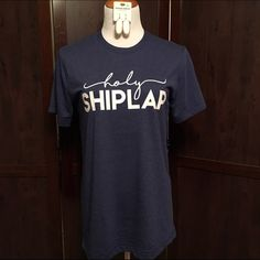 NWT Holy Shiplap Navy Blue Graphic Tee T Shirt If you love a good Fixer Upper and wish you could brunch with Joanna Gaines, you'll love this Holy Shiplap Tee! It's MADE IN TEXAS and SUPER soft! Runs true to size for a comfy fit. Paperback Boutique Tops Tees - Short Sleeve