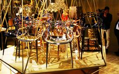 The Precious Kartell range in Milan 2014 pictured with the Masters Chair, Fly Light, Bourgie Lamp, and the Chrome stone stool, all designed by Philippe Stark, #Inspiration #Gold #Design